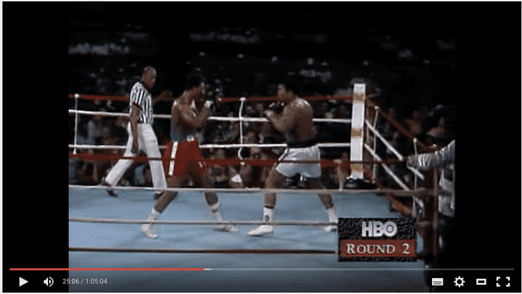 George Foreman (red) vs Muhammad Ali (white)